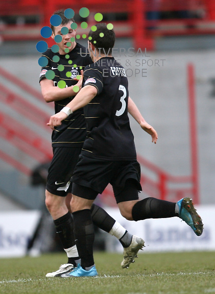 Zander Diamond (vice-captain) is congratulated on his goal by team mate Richard Foster during The Clydesdale Bank Premier League match between Hamilton and Aberdeen at New Douglas Park 06/03/10..Picture by Ricky Rae/universal News & Sport (Scotland).