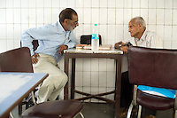 Regular customers sit and talk in the Indian Coffee House, Baba Kharak Singh Marg, New Delhi.