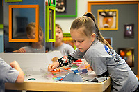 NWA Democrat-Gazette/JASON IVESTER<br /> Kaylee Smith, Tucker Elementary kindergartener, works on an art project Thursday, March 16, 2017, at the Scott Family Amazeum in Bentonville. About 100 students from the five kindergarten classes at the Rogers school were on a field trip at the museum.