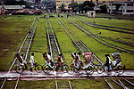 BANGLADESH-10016NF, Overgrown tracks give way to the road as cycle-rickshaws invade the railway yard, Dhaka, Bangladesh, Dacca to Peshawar, 1983<br />