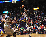"Ole Miss' Murphy Holloway (31) shoots over LSU's Johnny O'Bryant III (2) at the C.M. ""Tad"" Smith Coliseum in Oxford, Miss. on Saturday, February 25, 2012. (AP Photo/Oxford Eagle, Bruce Newman).."