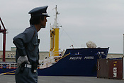 BNFL SHIPS 'PACIFIC PINTAIL' AND 'PACIFIC TEAL', UNDER GUARD, IN PORT IN KOBE, JAPAN, TODAY 260602, PREPARING FOR DEPARTURE TO TAKAHAMA TO COLLECT MOX PLUTONIUM WASTE WHICH WILL THEN BE TRANSPORTED BACK TO THE UNITED KINGDOM...PIC &copy; JEREMY SUTTON-HIBBERT/GREENPEACE 2002..*****ALL RIGHTS RESERVED. RIGHTS FOR ONWARD TRANSMISSION OF ANY IMAGE OR FILE IS NOT GRANTED OR IMPLIED. CHANGING COPYRIGHT INFORMATION IS ILLEGAL AS SPECIFIED IN THE COPYRIGHT, DESIGN AND PATENTS ACT 1988. THE ARTIST HAS ASSERTED HIS MORAL RIGHTS. *******