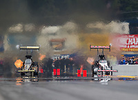 Oct 2, 2016; Mohnton, PA, USA; NHRA top fuel driver Steve Torrence (right) defeats Tony Schumacher during the Dodge Nationals at Maple Grove Raceway. Mandatory Credit: Mark J. Rebilas-USA TODAY Sports