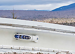 9 January 2016: Russian pilot Alexander Kasjanov leads his 4-man team as they cruise through Curve 14 during their second run of the day at the BMW IBSF World Cup Bobsled Championships at the Olympic Sports Track in Lake Placid, New York, USA. Kasjanov's team won the silver with a 2-run combined time of 1:49.98. Mandatory Credit: Ed Wolfstein Photo *** RAW (NEF) Image File Available ***