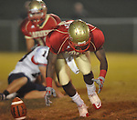 Lafayette High's Devontae Rogers (13) recovers a botched Lewisburg punt in Homecoming football action in Oxford, Miss. on Friday, September 30, 2011. Lafayette High won 42-0 for the team's 23rd straight win.