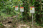 Warning signs at the beginning of the Kalalau Trail, Na Pali Coast, Kauai, Hawaii
