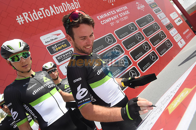 Mark Cavendish (GBR) Team Dimension Data and team mates sign on before the start of Stage 1 Emirates Motor Company Stage of the 2017 Abu Dhabi Tour, running 189km from Madinat Zayed through the desert and back to Madinat Zayed, Abu Dhabi. 23rd February 2017<br /> Picture: ANSA/Matteo Bazzi | Newsfile<br /> <br /> <br /> All photos usage must carry mandatory copyright credit (&copy; Newsfile | ANSA)