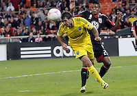 WASHINGTON, DC - OCTOBER 20, 2012:  Lionard Pajoy (26) of D.C United loses the ball to Federico Higuain (33) of the Columbus Crew during an MLS match at RFK Stadium in Washington D.C. on October 20. D.C United won 3-2.