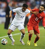 Washington, D.C.- May 29, 2014. Honduras midfielder Andy Najar shield the ball from Turkey National Olcay Sahan  Turkey defeated Honduras 2-0 during an international friendly game at RFK Stadium.