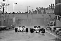 DETROIT, MI - JUNE 5: Nelson Piquet of Brazil in the Brabham BT52 3/BMW M12-13 drives ahead of Eddie Cheever of the United States in his Renault RE40 02/Renault Gordini during a wet practice session before the Detroit Grand Prix FIA Formula 1 race on the temporary street circuit in Detroit, Michigan, on June 5, 1983.