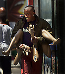 A men who appeared to be all the legs and arms strolled down 6th and Mission St. in San Francisco, California.