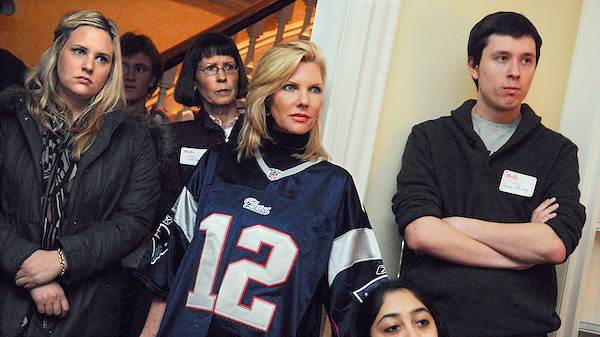 Exeter, New Hampshire: December 18, 2011<br /> <br /> Mary Kaye Huntsman (wearing jersey) attends a meet-the candidate house party featuring her husband and presidential candidate Jon Huntsman Jr. She wears a New England Patriots jersey because the team was playing at the time of the party. The blond woman standing beside her is her daughter Elizabeth 'Liddy' Huntsman, 23. It happened inside a private residence. &copy;Chris Fitzgerald / CandidatePhotos