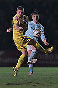 15.01.2013. Torquay, England. Captain's fight. Exeter's Danny Coles clears ahead of Torquay's Lee Mansell's charge during the League Two game between Torquay United and Exeter City from Plainmoor.