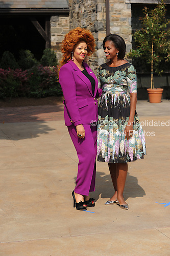 United States First Lady Michelle Obama, right, and Chantal Biya of Cameroon, left, visit Stone Barns Center in Pocantico Hills, New York on Friday, September 24, 2010 with a large group of other First Ladies visiting New York for the United Nations General Assembly. They viewed the mobile chicken coop and herb garden while making a tour of the facilities.  .Credit: Andrea Renault / Pool via CNP