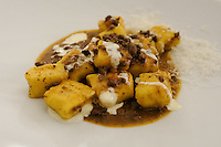 The first course of red mountain potato gnocchi with hare ragout and Testun (cheese) drops € 17 at Pappagallo, Bologna. The Pappagallo Restaurant in Bologna was established in 1919. It continues to serve traditional Bolognese cuisine. Photo Sydney Low