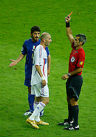 Jul 9, 2006; Berlin, GERMANY; France midfielder (10) Zinedine Zidane is issued the red card by referee Horacio Elizondo (Argentina) as Italy midfielder (8) Gennaro Gattuso looks on during extra time against Italy in the final of the 2006 FIFA World Cup at the Olympiastadion, Berlin. Italy defeated France 5-3 on penalty kicks following a 1-1 draw after extra time. Mandatory Credit: Ron Scheffler-US PRESSWIRE Copyright © Ron Scheffler