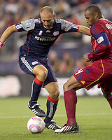 New England Revolution forward Ilija Stolica (9) after receiving pass works to get a shot as Real Salt Lake defender Jamison Olave (4) defends. Real Salt Lake defeated the New England Revolution, 2-1, at Gillette Stadium on October 2, 2010.