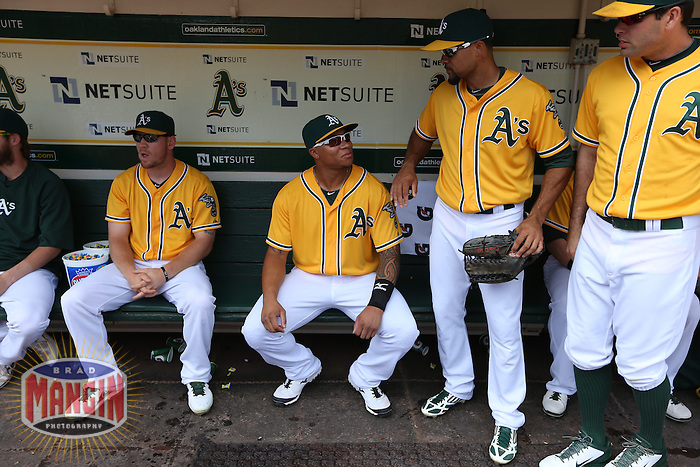 OAKLAND, CA - SEPTEMBER 2:  Michael Choice #35 and Coco Crisp #4 of the Oakland Athletics talk in the dugout before the game against the Texas Rangers at O.co Coliseum on Monday, September 2, 2013 in Oakland, California. Photo by Brad Mangin