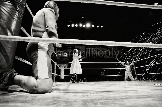 A wrestler acknowledges the crowd prior to a bout during Doglegs, an event for wrestlers with physical and mental handicaps in Tokyo, Japan.
