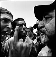 Newe Dekalim Settlement, Gaza strip Israel, Aug. 2005..Violent shuffles between the police and settlers refusing the evacuation.