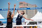 GULF SHORES, AL - MAY 07:  Nikki Lyons (4)  of Pepperdine hits the ball past Jenna Belton (31) of the University during the Division I Women's Beach Volleyball Championship held at Gulf Place on May 7, 2017 in Gulf Shores, Alabama.The University of Southern California defeated Pepperdine 3-2 to claim the national championship. (Photo by Stephen Nowland/NCAA Photos via Getty Images)