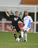 Jed Zayner #12 of D.C. United tackles Geovanni #77 of the San Jose Earthquakes during an MLS match at RFK Stadium in Washington D.C. on October 9 2010. San Jose won 2-0.