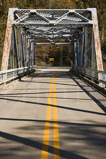 Old metal girder highway bridge in the mountains carrying narrow two lane highway, Red River Gorge, Slade, Kentucky, KY, USA.