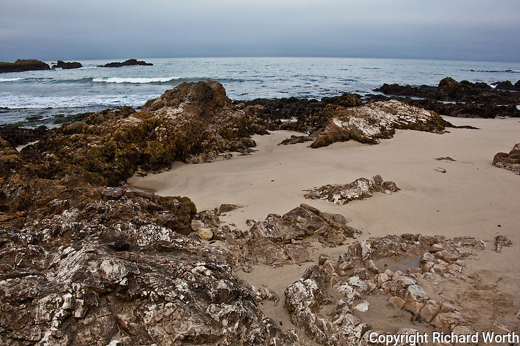 Rocks, sand, ocean and sky - Pescadero State Beach, California.