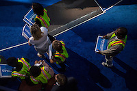 Convention workers prepare to distribute signs featuring President Barack Obama's campaign slogan to the audience at the Democratic National Convention on Thursday, September 6, 2012 in Charlotte, NC.