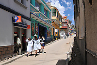 School girls walking down street in Potosi, Bolivia