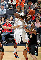 Dec. 22, 2010; Charlottesville, VA, USA; Virginia Cavaliers guard K.T. Harrell (24) grabs a rebound in front of Seattle Redhawks forward Chad Rasmussen (15) during the game at the John Paul Jones Arena. Seattle Redhawks won 59-53. Mandatory Credit: Andrew Shurtleff