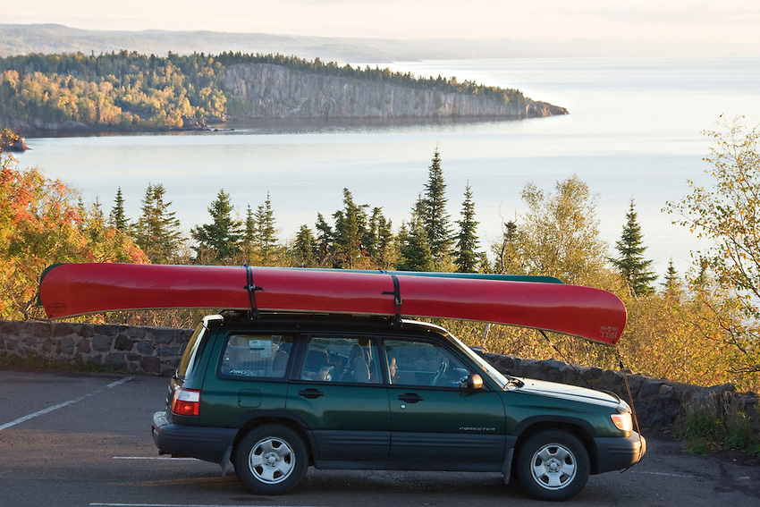 A car with canoes at Palisade Head and Shovel Point in Tettegouche State Park on Minnesota North Shore.