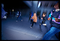 Anti racist protesters run from police during a protest.Oslo Norway.