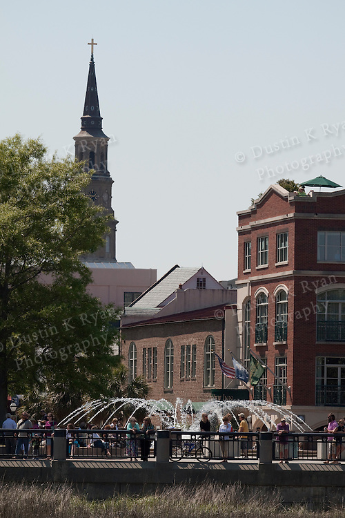 charleston waterfront park and water fountain st josephs church steeple in the background