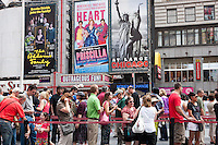 People stand in line to purchase discount theater tickets at the TKTS booth in Times Square, New York City