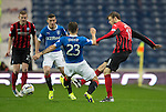 Rangers v St Johnstone....28.10.14   Scottish League Cup Quarter Final at Ibrox<br /> Murray Davidson is tackled by Richie Foster<br /> Picture by Graeme Hart.<br /> Copyright Perthshire Picture Agency<br /> Tel: 01738 623350  Mobile: 07990 594431