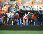 Ole Miss running back Brandon Bolden (34) is tackled by Tennessee defensive back Brent Brewer (17) in a college football game at Neyland Stadium in Knoxville, Tenn. on Saturday, November 13, 2010. Tennessee won 52-14.