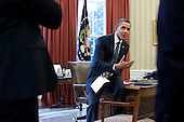 United States President Barack Obama talks with senior advisors in the Oval Office, February 29, 2012. .Mandatory Credit: Pete Souza - White House via CNP