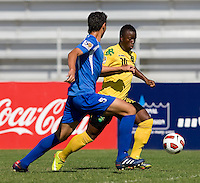 Jason Wright (10) of Jamaica sprints past Jeffri Flores (5) of Honduras during the quarterfinals of the CONCACAF Men's Under 17 Championship at Catherine Hall Stadium in Montego Bay, Jamaica. Jamaica defeated Honduras, 2-1.