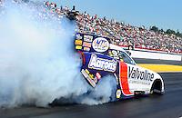 Mar. 13, 2011; Gainesville, FL, USA; NHRA funny car driver Jack Beckman does a burnout during eliminations at the Gatornationals at Gainesville Raceway. Mandatory Credit: Mark J. Rebilas-