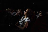 Members of the audience watch the premiere of director Joud Said's latest film, 'My Last Friend', in Al-Kindi Cinema in Mashru Dummar, Damascus, Syria.
