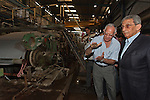 Egyptian Presidential candidate Amr Moussa (r) tours a recycling plant in the Nile Delta region near the city of Banha May 5, 2012. Moussa has made the economy one of his campaign's central emphasis, promising to return it to strong growth in a short time frame through support for industry and trade.