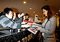 Narita, Japan - April 14th 2012 : Actress Jessica Alba signs an autograph for a Japanese fan upon arrival at Narita Airport in Japan. She is visiting with her daughters Haven Garner Warren and Honor Marie Warren and her husband Cash Warren.