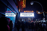 People walk under snow near the Apollo theater in New York  01/17/2016 Photo by VIEWpress
