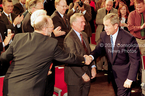 United States President Bush thanks Winston Wiley, Deputy Director of Intelligence as Dr. Donald Kerr, Deputy Director of Science and Technology, looks on following the president's speech to Central Intelligence Agency employees at  CIA headquarters in Langley, Virginia on September 26, 2001. .Credit: Martin Simon / Pool via CNP