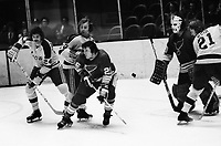 California Golden Seals vs St. Louis Blues 1972.<br />Blues Gary Veneruzzo, and goalie Jacques Caron defend against Seals, Pete Laframboise, Joey Johnston and Stan Weir.(photo by Ron Riesterer)
