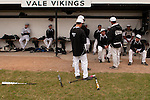 Vale coach Rick Yraguen talks to his team before the start of their game agaisnt New Plymouth at Vale High School's Cammann Field on April 28, 2011.