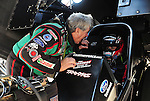 May 18, 2012; Topeka, KS, USA: NHRA funny car driver John Force talking to daughter Courtney Force before qualifying for the Summer Nationals at Heartland Park Topeka. Mandatory Credit: Mark J. Rebilas-