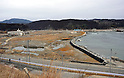 March 8, 2012, Minamisannriku-cho, Japan - A wide swath of barren land stretches along the coast at Minamisannriku-cho, Miyagi Prefecture, some 365 km northeast of Tokyo, on Thursday, March 8, 2012. ..One year after the strongest earthquake ever to hit Japan, the economy is recovering and massive cleanup operations are in full swing throughout much of the countrys northeastern region. But once-pastoral landscapes that were piled with rubble and debris have become empty wastelands due mainly to bickering and disagreements between the central and local governments over rebuilding the devastated region. A year later, more than 260,000 people still live in temporary shelters. (Photo by Natsuki Sakai/AFLO) AYF -mis-.