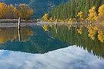Idaho, Silver Valley, Rose Lake, Reflections in the water with rising mist and autumn colors.